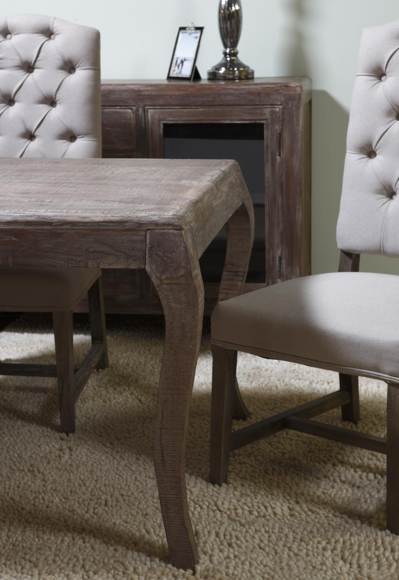 Light Colored Table And Cushioned Chairs